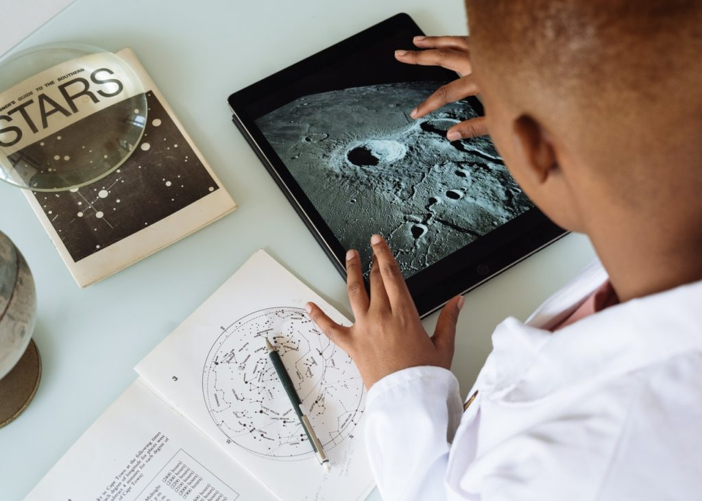 crop-african-american-student-studying-craters-of-moon-on-3825569
